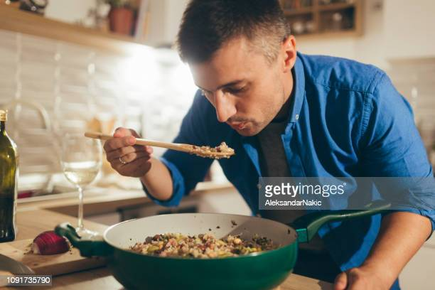 let's taste this risotto - one man only stock pictures, royalty-free photos & images