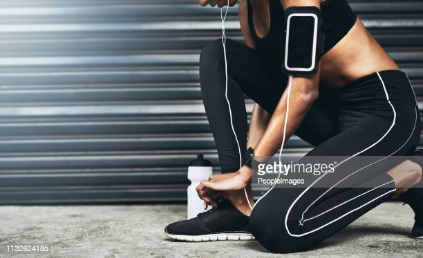 let's tie these up and get running - arm band stock pictures, royalty-free photos & images