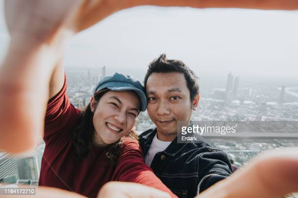 let's traveling to bangkok - heterosexual couple stock pictures, royalty-free photos & images