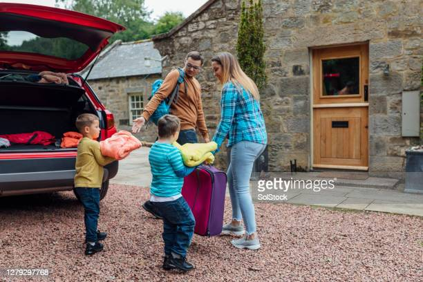 let's unpack the car - vacations stock pictures, royalty-free photos & images