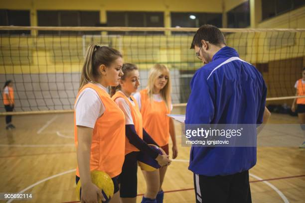 let's win this game - high school volleyball stock photos and pictures