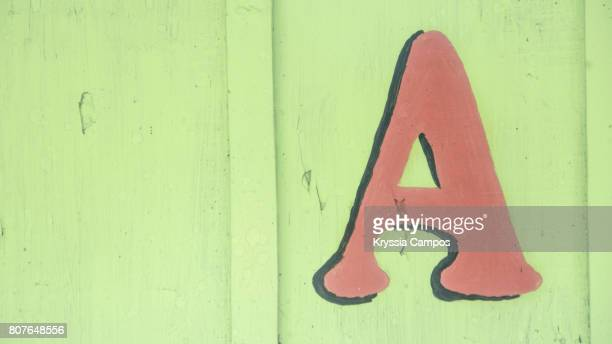 Letter A painted in wooden wall, Guatemala