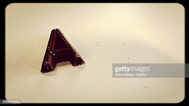 Letter A Written With Chocolate On Table