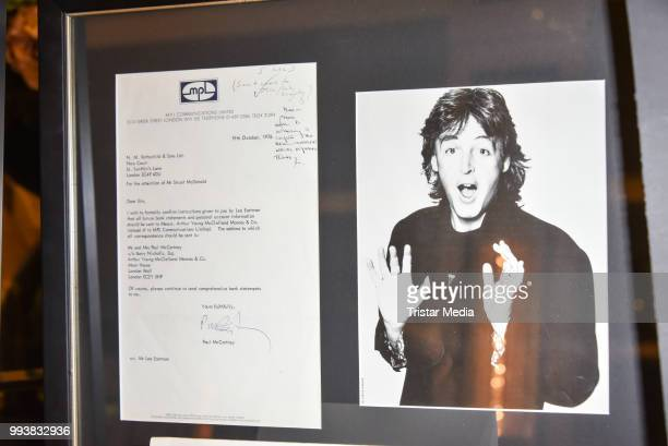 A letter and picture signed by Paul McCartney as a detail during the Aline Reimer Foundation Gala on July 7 2018 in Berlin Germany