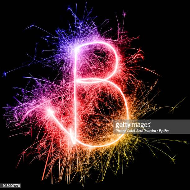 letter b made by multi colored sparklers at night - letra b imagens e fotografias de stock