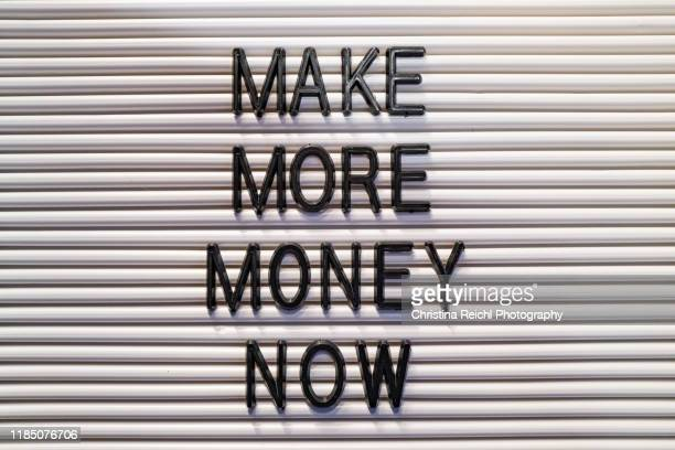 """letter board reading """"make money"""" - capitalism stock pictures, royalty-free photos & images"""