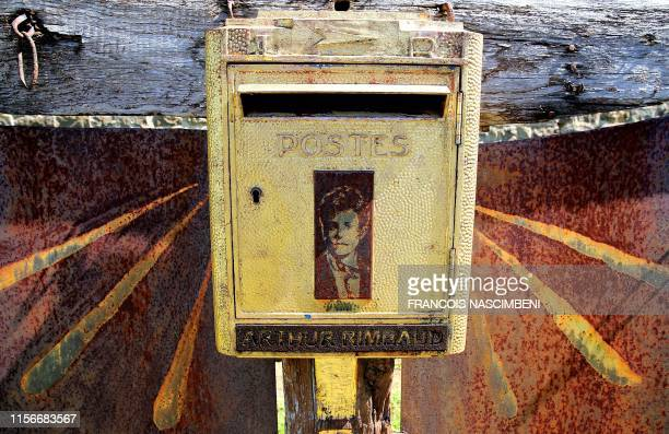 Letter box dedicated to the French poet Arthur Rimbaud is pictured at the west cemetery of Charleville-Mezieres on June 21, 2019. - Two or three...