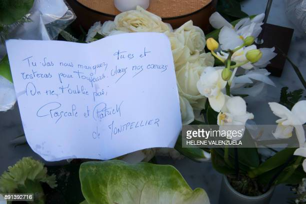 A letter by fans is pictured on the tomb of late French music icon Johnny Hallyday on the French Caribbean island of SaintBarthelemy on December 12 a...
