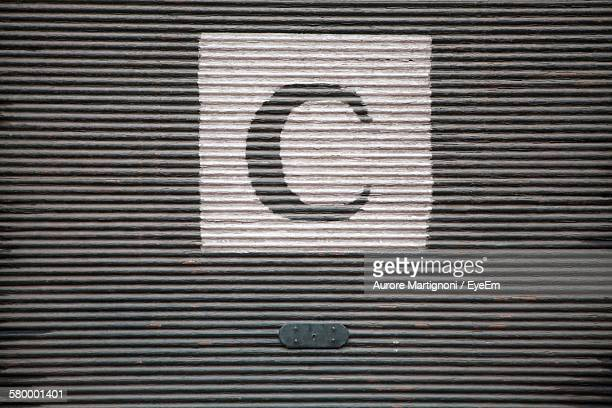 Letter C On Closed Shutter