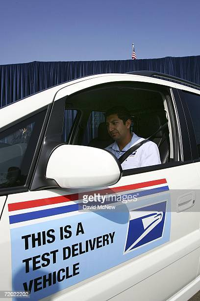 Letter carrier Aldo Vasquez starts up a General Motors HydroGen3 fuel cell minivan as officials unveil the new vehicle to be added to the U.S. Postal...