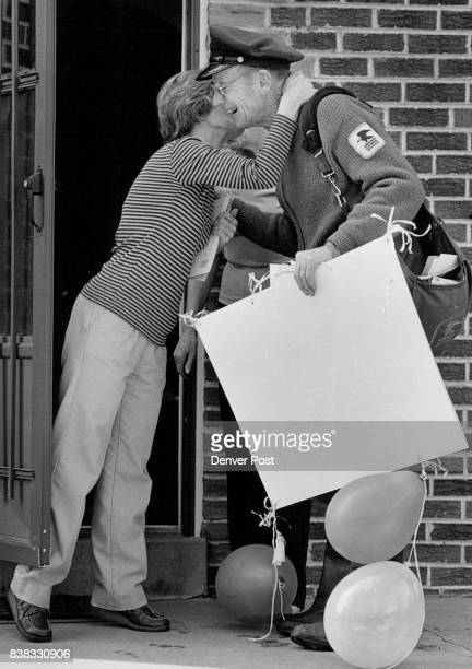 Letter Carrier John Rudolph receives a kiss from his postal patron Doris Brent On Thursday Rudolph's last day before A retirement he found signs and...