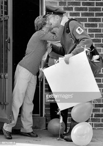 Letter Carrier John Rudolph recieves a kiss from his postal patron Doris Brent On Thursday Rudolph's last day before retirement he found signs and...