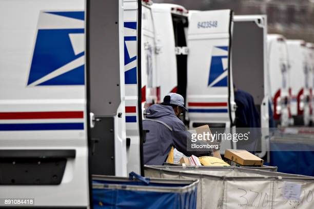 A letter carrier prepares a vehicle for deliveries at the United States Postal Service Joseph Curseen Jr and Thomas Morris Jr processing and...