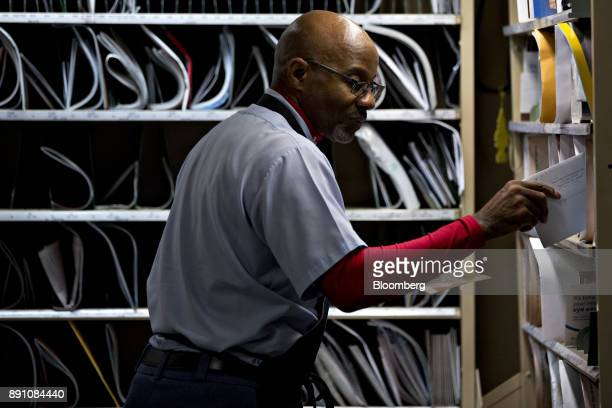 A letter carrier prepares mail for delivery at the United States Postal Service Joseph Curseen Jr and Thomas Morris Jr processing and distribution...