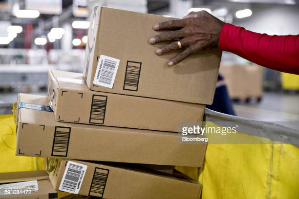 A letter carrier sorts packages for delivery at the United States Postal Service Joseph Curseen Jr and Thomas Morris Jr processing and distribution...