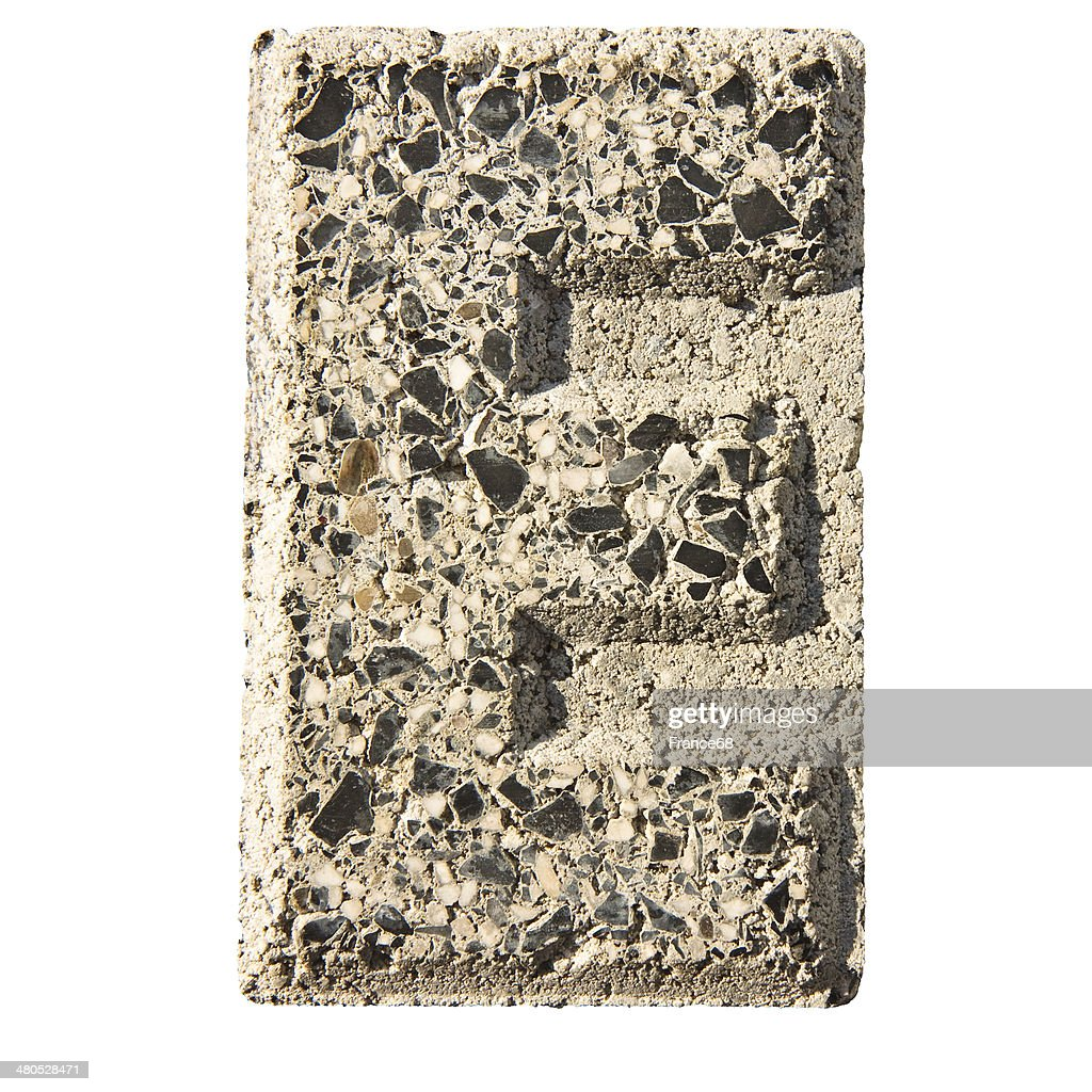 Letter E carved in a concrete block : Stock Photo
