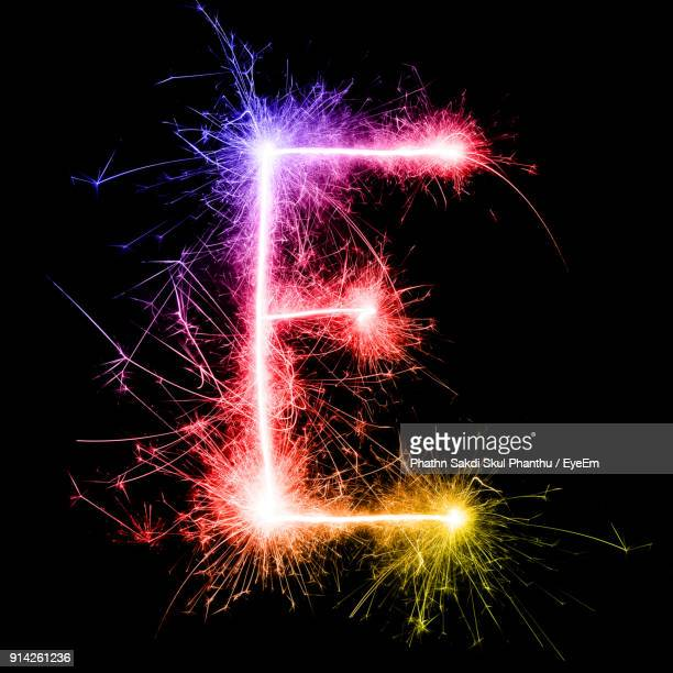 Letter E Made By Multi Colored Sparklers At Night