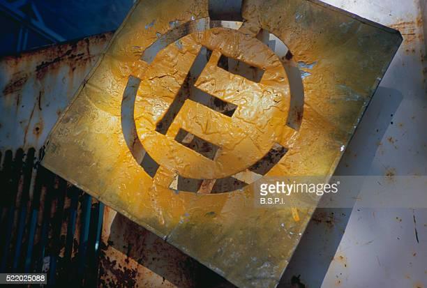 Letter E Stencil Covered with Yellow Spray Paint