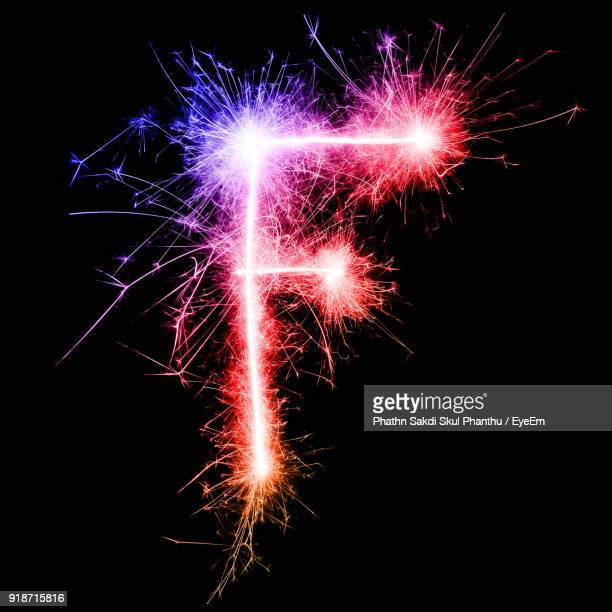 Letter F Made By Multi Colored Sparklers At Night
