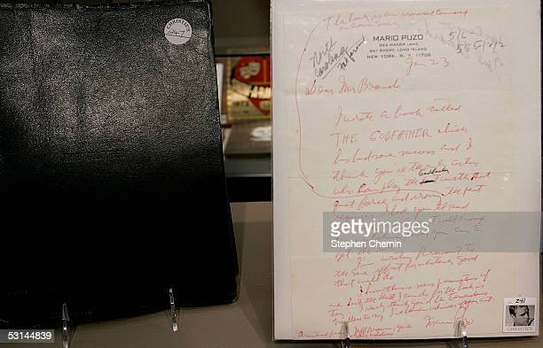 A letter from Mario Puzo author of The Godfather rests next to Marlon Brando's script from the movie at Christie's Auction House June 24 2005 in New...