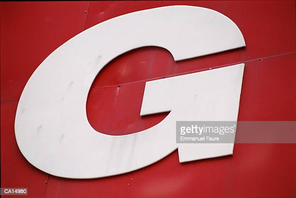 Letter 'G' on red wall, close-up