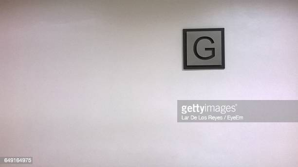 Letter G Sign On White Wall