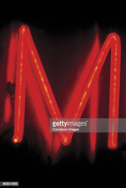 Letter M on neon sign