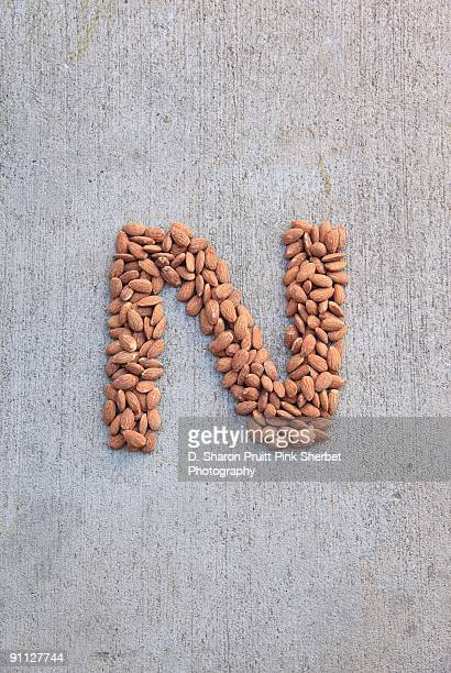 letter n for nuts - letter n stock pictures, royalty-free photos & images
