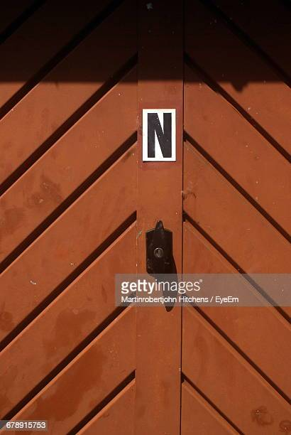 Letter N On Brown Door
