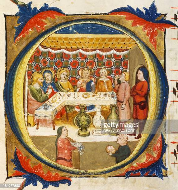 Letter O depicting the Supper at Emmaus from an illuminated coral by Turone manuscript Italy 14th century Verona Biblioteca Capitolare