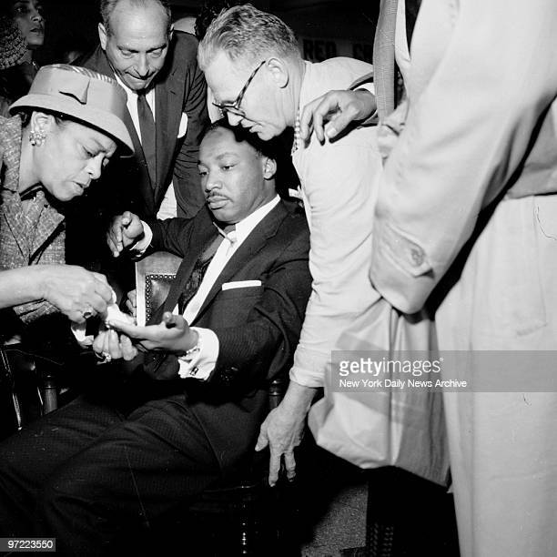 A letter opener protruding from his chest the Rev Martin Luther King has would treated at W 123rd St police station The leader of a bus boycott by...
