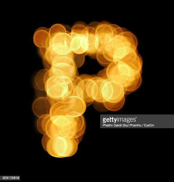 letter p made with lens flares against black background - letter p stock pictures, royalty-free photos & images