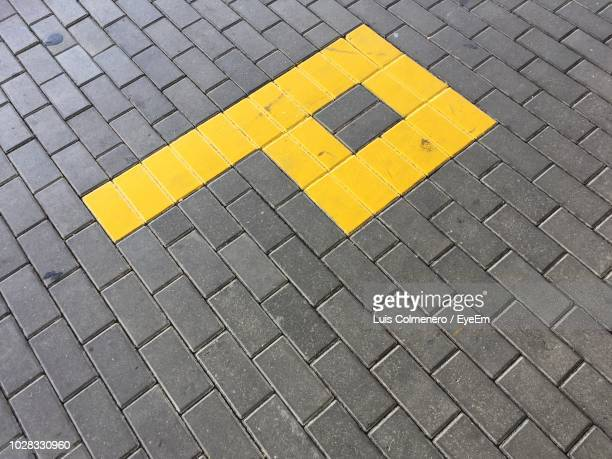letter p on paved street - letter p stock pictures, royalty-free photos & images