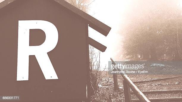 Letter R On House During Foggy Weather