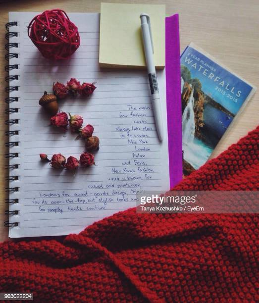 letter s made from flowers by fabric and book at table - letter s stock photos and pictures
