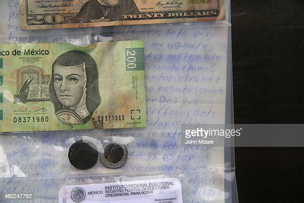 A letter to a loved one money and Mexican voting identification are kept in a sealed bag of personal effects at the Pima County Office of the Medical...