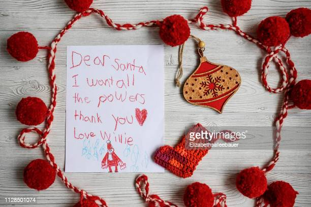 a letter to santa asking for superhero powers - capital letter stock pictures, royalty-free photos & images