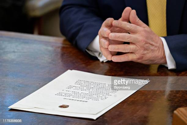 Letter to U.S. President Donald Trump from Chinese Vice Premier Liu He sits on the Resolute Desk in front of Trump during a meeting with Liu He, not...