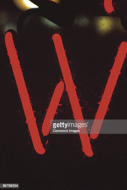 Letter W on neon sign
