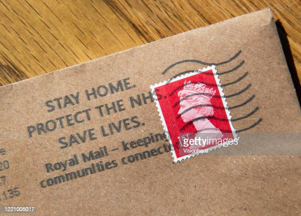 Letter with the franking stamp encouraging people to Stay Home, Protect the NHS and Save Lives on April 24, 2020 in Manchester, England. The British...