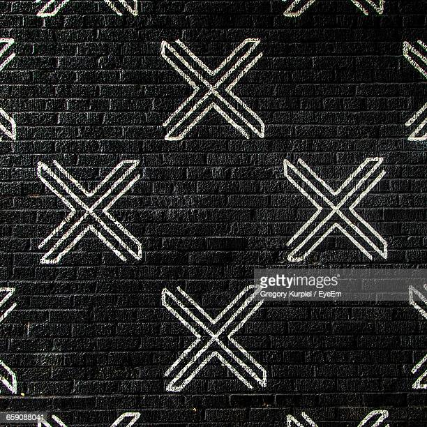 Letter X On Black Wall