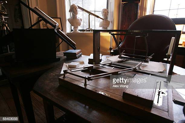A lettercopying device with two pens attached known as a polygraph lies on Thomas Jefferson's desk in the Cabinet area August 17 2005 at Monticello...