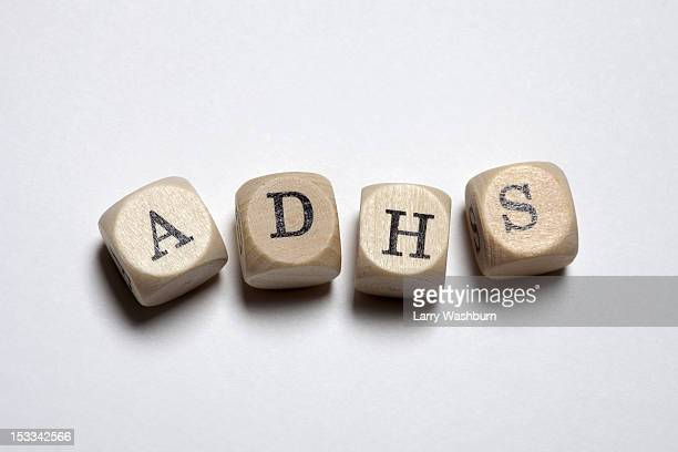 Lettered cubes spelling ADHS, the German acronym for Attention Deficit Hyperactivity Disorder