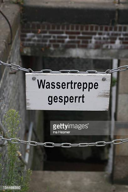 Lettering Wassertreppe gesperrt, German for water stairs closed, Speicherstadt district, Hamburg, Germany, Europe