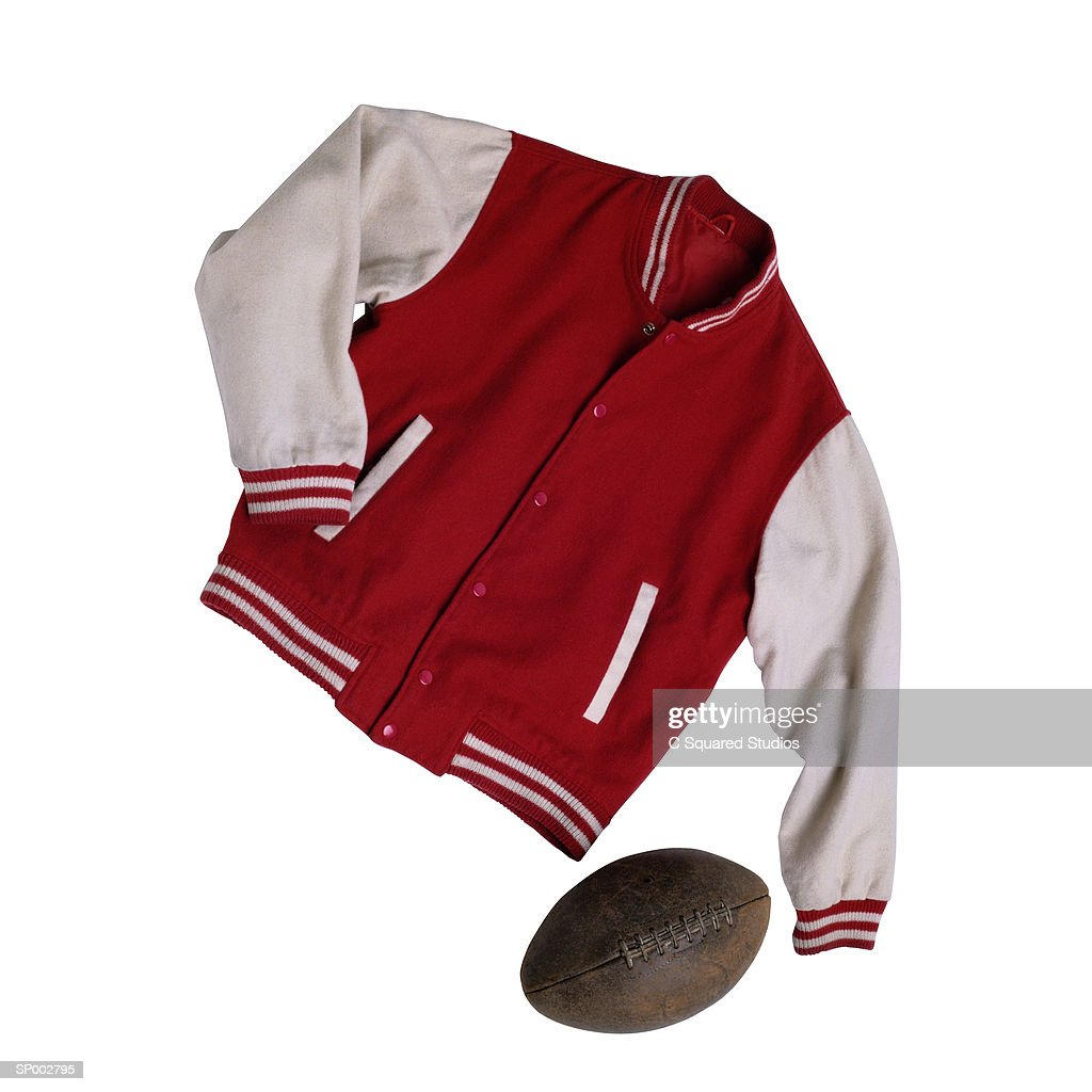 Lettermans Jacket and Football : Stock Photo