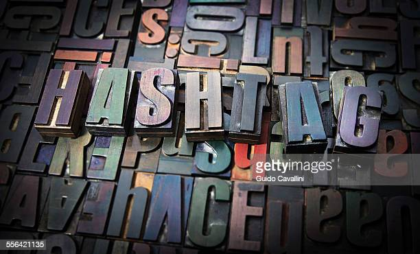 Letterpress letters spelling the word Hashtag