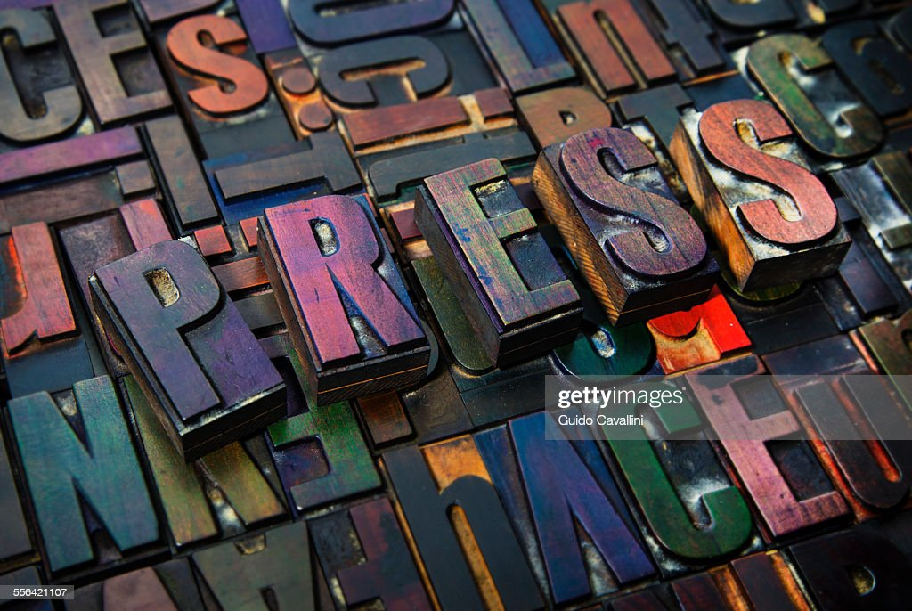 Letterpress letters spelling the word Press : Stock Photo