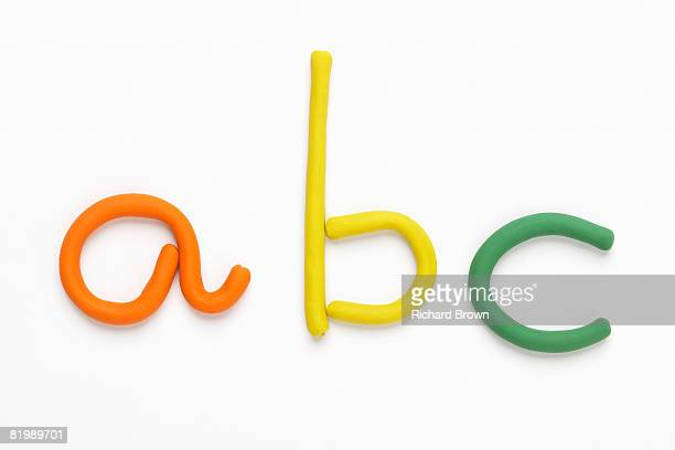 letters a, b and c made with modelling clay - clay stock pictures, royalty-free photos & images