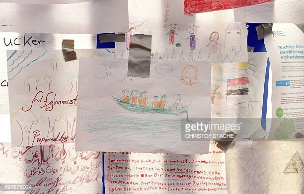 Letters and children's paintings of migrants are fixed in a waiting tent for migrants at the central train station in Passau southern Germany on...