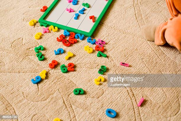 Letters and numbers scattered on floor